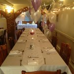 Tables dressed and ready for the guests to celebrate.