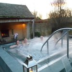 Raising a glass (or two) in the hot tub with the log fire beside us