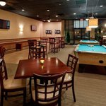  Scorzz features 2 pool tables, a dart board, and shuffle board