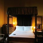                    Room #4, with a four-poster bed and high ceilings