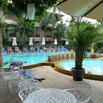                    Pool area. Like a paradise a few steps away from the beach boulevard.