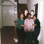 Rowan daughters in back row with the three of us, on the stairs by our room.