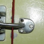  Safety lock in door with loose and missing screws