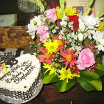                    Birthday suprise of fresh flowers and a cake!