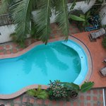 View to small pool by the building with geckos on the wall