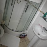 Nice bathroom with power shower. Shame the drain was partially blocked.