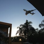 Approaching airplane over pool area