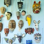                    a wall of masks at the casa