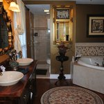 Jacuzzi, shower and double sinks with fireplace