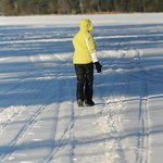 Follwing my wife across frozen Friends Lake.