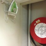 The ironing facilities safely tucked away in the fire hose cupboard.