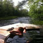 Cedar hot tub next to the beautiful Tusket River
