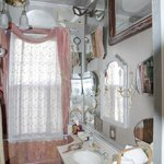                    bathroom filled with electic mirror collection