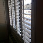 No curtains, plastic slats = bright sleepl