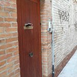 First exterior door- access to B&B in the alleyway next to cafe