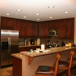 Well appointed kitchen with breakfast bar