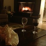                    A glass of wine by the fire