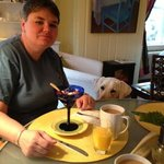 Enjoying the delicious breakfast while our well manned dog watches.