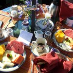 Our delicious tropical fruit, coffe, juice, and bread breakfast