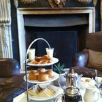 Afternoon tea and a real log fire.