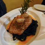 Squid ink pasta, topped with mahimahi, scallops & fresh rosemary
