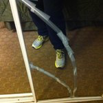 Broken mirror fixed with scotch tape