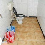                    Bathroom with buckets awaiting hot water delivery