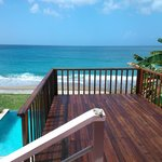 Apartment 1 Deck over looking pool and beach