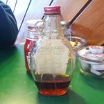 Dried maple syrup caked onto bottle in dining room.