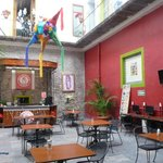                    the covered courtyard/breakfast place of hostel Santo Domingo
