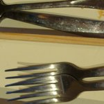 Rusted and dirty silverware in drawer
