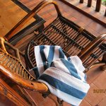                    Lovely cane chairs and loungers on the wooden porch, a touch of nature all aro