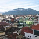 view of Bukittinggi with mount merapi from hotel bedroom