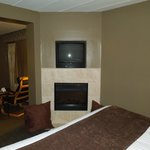 TV and Fireplace in bedroom of suite