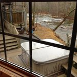                    View of outside deck area with Hot tub and Chiminea behind the Firefly Cabin
