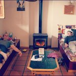 The guys, relaxing by the woodstove in our cottage.