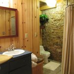 Rustic bathroom -shower curtain on right