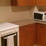                    Kitchen stove, bench and microwave