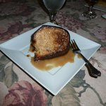 Almond pound cake with almond streusel and warm maple butter sauce.
