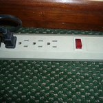 Power Strip in Living Area.  TV plugged into this unit.