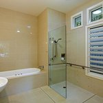 Modern ensuites with spa bath & separate shower , floor to ceiling tiles