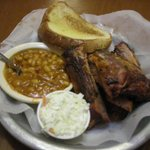 Signiture dish, pork ribs, beans, coleslaw and Garlic Bread