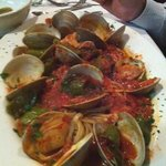 Clams in red sauce over linguini