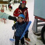 little Henry and his ski instructor - so close to hotel