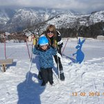 mum & henry on ski slopes just behind hotel