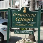 sign in front of cottages