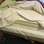 this is how bed was the spread was thrown over the bed mattress off bed.