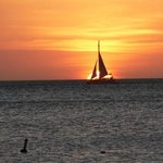 sailboat during sunset