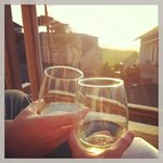                    Enjoying the sunset and complimentary wine on the Pana Sea Ah deck