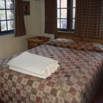                    the bed in one queen cabin